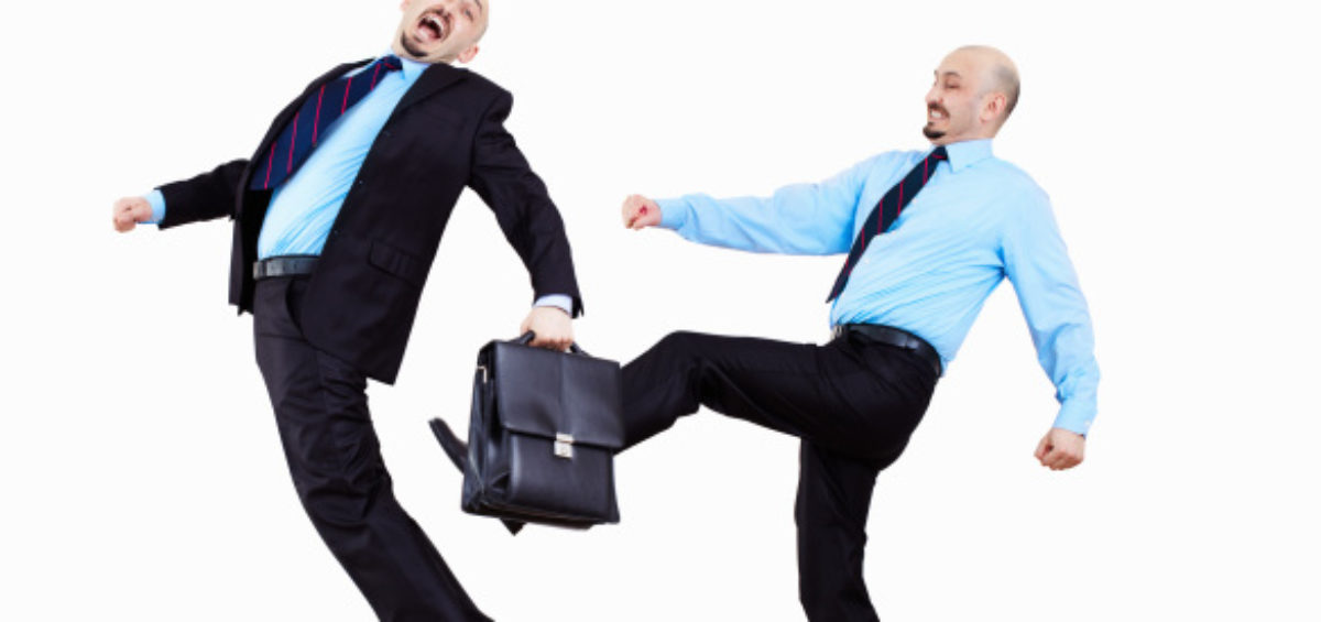 coworker kicking coworker with briefcase